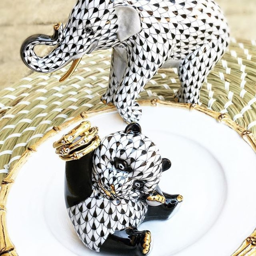 Raise your hand if you love these 2016 @herendusa introductions as much as we do!   Asian Elephant and Playful Panda holding a yummy 18k yellow and white gold bamboo ring #bamboo #herend #panda #asianelephant #figurines #shopelizabethbruns #brunsbling