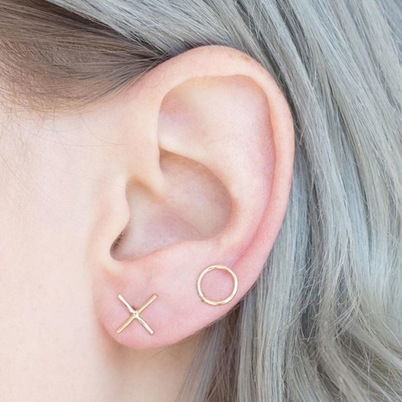 These mismatched XO studs by @onesixfivejewelry are a part of our #adorable 2016 holiday gift sets - stop by tomorrow and pick them up before they're gone!!