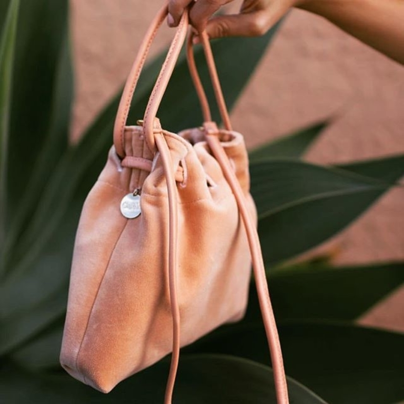 The prettiest little going out bag on We love the petit Henri from @clarevivier because it can slip over your wrists for a hands free night or it comes with a cross body strap #ourfavorite #blushpink #goeswitheverything #giftideas