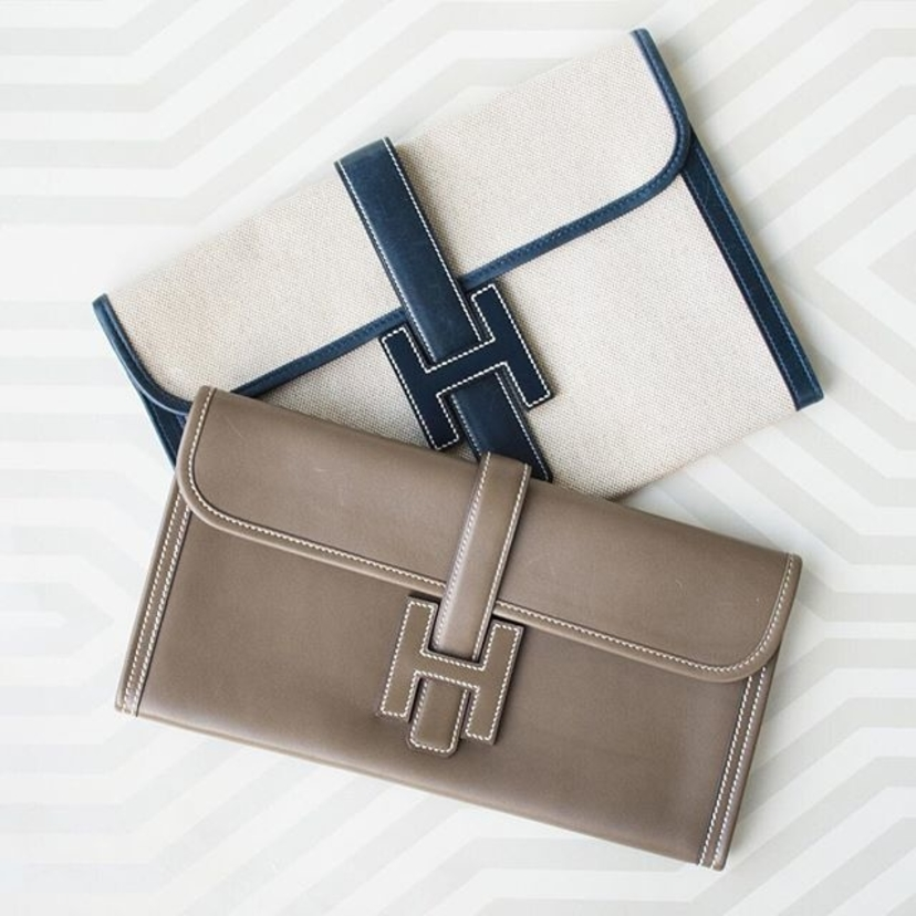 Hermes Natural Canvas & Navy Box Calf Leather 'Jige PM' Clutch and Hermes Etoupe Swift 'Jige Elan' Clutch.  Contact @lgsdiana for pricing and information.