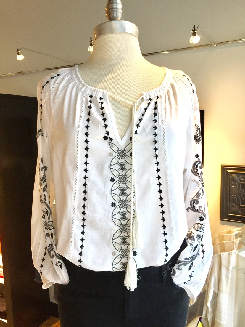 Sparkling white embroidered blouse