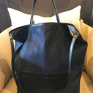 Denim and leather color blocked and made, of course, in Italy. A detachable shoulder strap, double handles, open top...this bag is sooooo good looking.