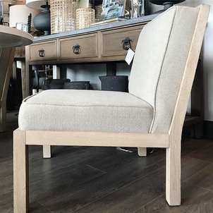 Pale wood. Linen upholstery. Sits low. Handsome.
